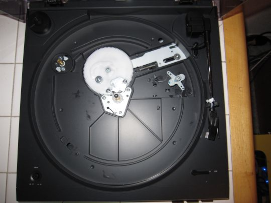 Photo shows view of the Audio-Technica AT-LP2D-USB turntable unassembled turnable from above. Motor and pully are visible.