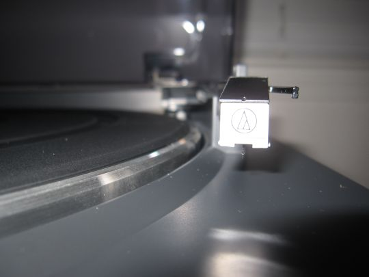 Close-up photo shows the Audio-Technica AT-3600L cartridge and stylus mounted on the tonearm of a Audio-Technica AT-LP2D-USB turnable.
