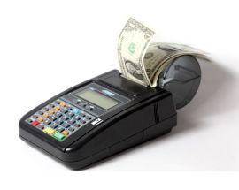 Photo of a credit card machine. The receipt printer is dispensing dollar bills instead of a receipt.