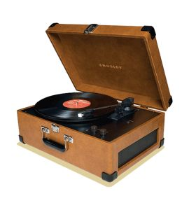 Marketing photo shows the Crosley CR249 turntable with cover open, playing a record.