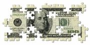 An illustration of a $100 bill jigsaw puzzle with several pieces missing.