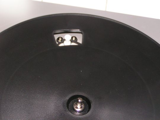 Photos shows belt around a pulley through a hole in the bare turntable platter on the Ion Audio TTUSB05.