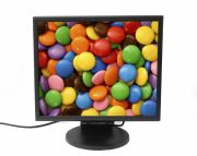 Photo of a computer monitor displaying colorful, M&M-like candy.
